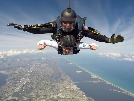 TJ Amdahl, top, petty officer 1st class with the Navy parachute team, the Leap Frogs, and TCPalm's Dacia Johnson skydive Nov. 4  from 12,500  feet during the team's practice run before the Stuart Air Show.