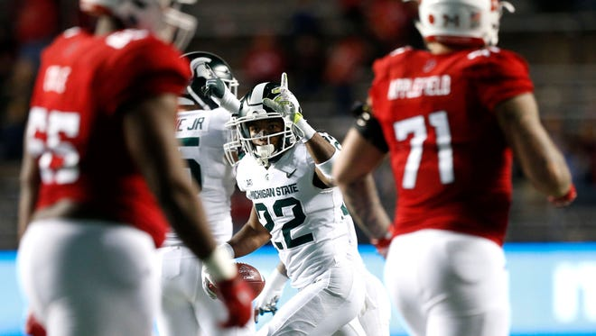 Nov 25, 2017; Piscataway, NJ, USA; Michigan State Spartans cornerback Josiah Scott (22) celebrates after an interception against Rutgers Scarlet Knights during second half at High Point Solutions Stadium.
