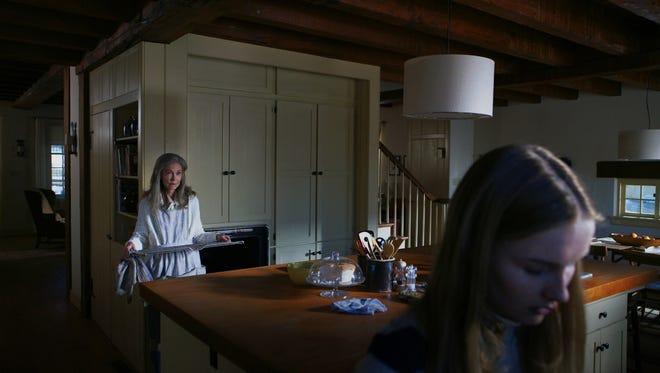 "Nana (Deanna Dunagan) has a job for young Becca (OLIVIA DEJONGE) in ""The Visit."""