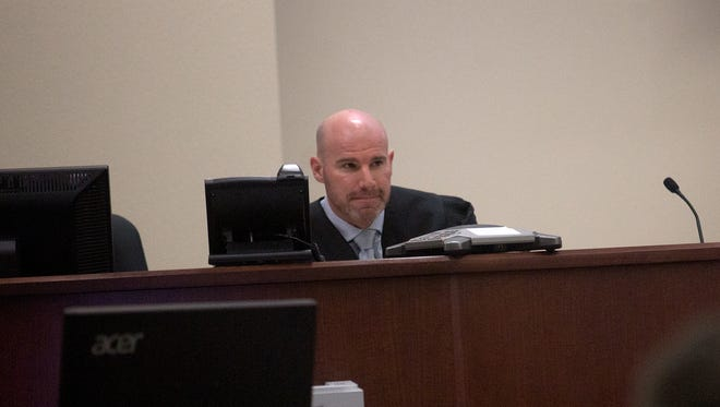 District Judge Bradford Dalley presides over a hearing in a lawsuit between Farmington and Bloomfield officials May 10 in Aztec District Court.