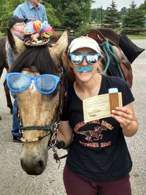 Marine City Spanish teacher and track and field coach Kristen Humble recently completed her fifth ride across the state on horseback.