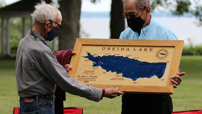 Dr. John Forney is presented with the Oneida Lake Association's 2020 75tth anniversary Conservationist of the Year Award by Dr. Ed Mills.