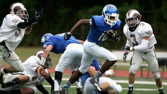Metuchen football player #10 Danny Briggs runs in for a touchdown in the first half against South River high school in a game at Metuchen high school Saturday September 13, 2014 photo by Ed Pagliarini EST 0914 FB South River-Metuchen