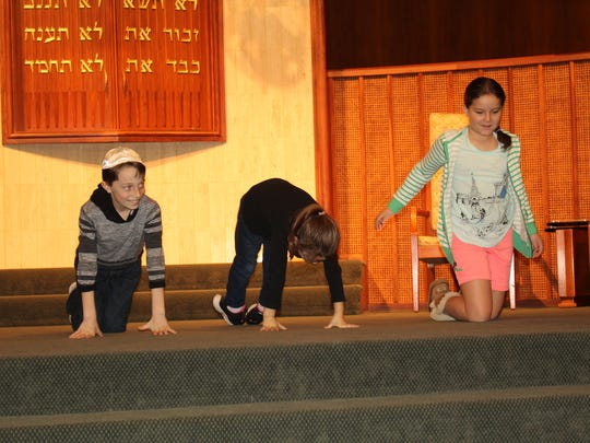 "Asher and Dina Hagler along with Celeste Scott demonstrate their version of ""Hebrew Yoga"" during a program honoring the memory of the late Elliot Stevens Sunday. Alvin Benn/Special to the Advertiser"
