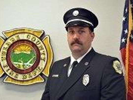 Kevin Riggi was promoted to Tulare County Fire Dept. Battalion Chief at a ceremony Friday.
