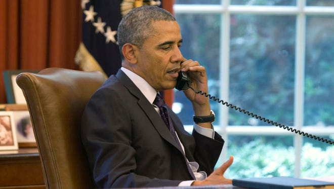 President Obama speaks on the phone in the Oval Office on June 2.