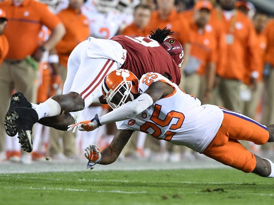 Clemson cornerback Cordrea Tankersley (25) brings down Alabama running back Bo Scarbrough (9) during the first quarter of the national championship game on Jan. 9.