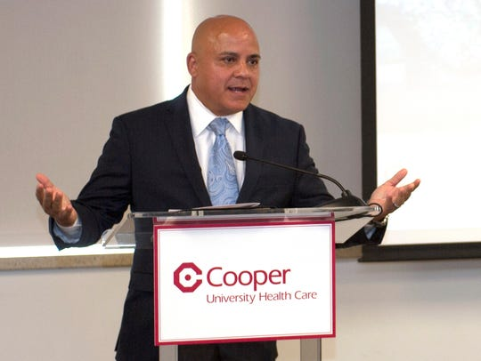 Camden City Councilman Frank Moran announces the Cooper Health Careers Initiative,  which offers studentsfree training for careers in medical coding, a skill that, according to Cooper CEO Adrienne Kirby, is in demand at Cooper and throughout the region.