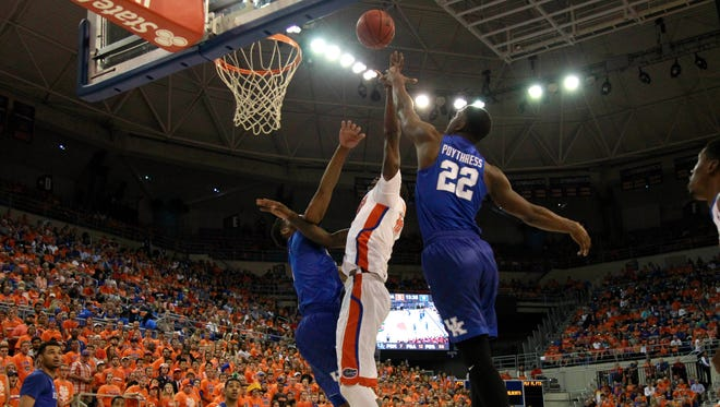 Mar 1, 2016; Gainesville, FL, USA; Kentucky Wildcats forward Alex Poythress (22) fouls over Florida Gators forward Dorian Finney-Smith (10) and shoots and one during the first half at Stephen C. O'Connell Center.