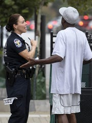 Sgt. Ruby Ellison talks with a man who crossed Broadway