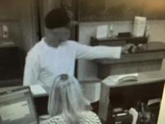 A surveillance photo of the suspected robber.