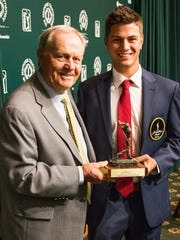 University of West Florida junior Chandler Blanchet (right) accepts his Division II National Player of the Year trophy from the award's namesake, Jack Nicklaus, on Sunday, June 4, 2017, at the PGA Tour Memorial Tournament in Ohio.