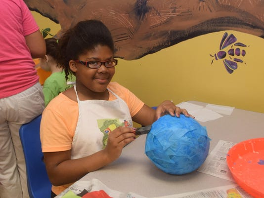 ANI TREE House Art Camp Franjone' Price makes a paper mache birdhouse Wednesday, June 24, 2015 during a summer camp held at the T.R.E.E. House Children's Museum.-Melinda Martinez/The Town Talk