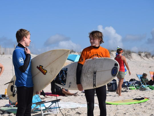 Ben McCabe, 13, and Ben Carper, 14, discuss the waves