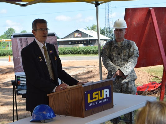 ANI LSUA Rugby Pitches LSUA Chancellor Dan Howard (left) and Capt. Mike D'Aguiar of the Louisiana National Guard's 844th Horizontal Engineering Company announce that a project to construct two new rugby fields and a pond at LSUA as part of LSUA's Campus Fa