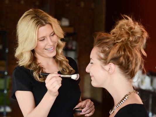 Ashley applying makeup