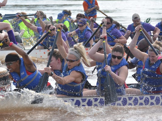 ANI Dragon Boat Races CrossFit South Bank dragon team members April Jones (left), Lisa Lauve and Kaitlyn Johnson dig in as they compete against the Rapides Life Savers of Rapides Regional Medical Center and Reaux Power of CLECO. The 5th annual Louisiana Dr