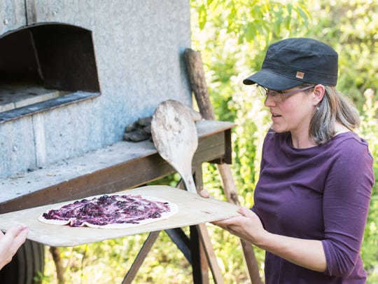 Geyer's Oven owner Anna Geyer working the metal oven.