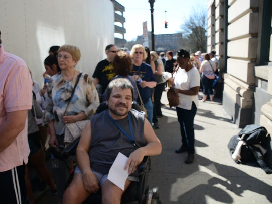 A line stretched around the Lost Dog Cafe Sunday of eager locals waiting to see Chelsea Clinton speak in support of her mother's presidential campaign.