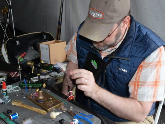 Greg Senyo of Steelhead Valley Outfitters in Girard, Pa., works on a fly for steelhead trout during the South River Fly Fishing Expo in Waynesboro on Saturday, April 23, 2016.