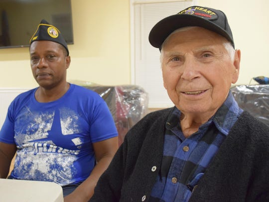 Disabled American Veterans Chapter 66 members Glenn Crowder and Angelo M. Scaltrito welcome the church donation during the Nov. 2 meeting of the DAV in Hammonton.