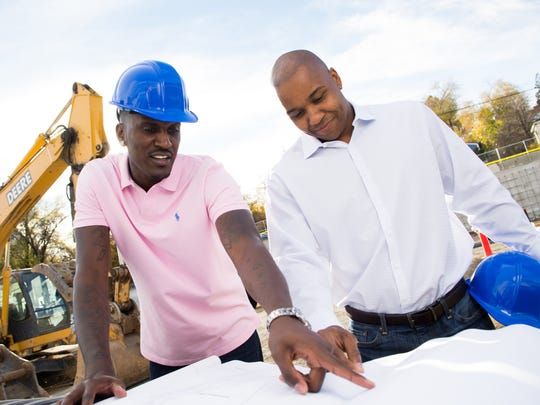 """Kevinn Pinkney, left, and Garry Hill-Thomas, Co-CEO's of Pink Hill Properties, the developers of the Towers at Pink Hill on Virginia Street, review plans at site in November 2016. Former Nevada basketball teammates from Nevada's """"Sweet 16"""" team of 2004, the two entrepreneurs also own Keys café at Lake Tahoe."""