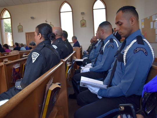 Local law enforcement officers follow along with the Blue Mass on Friday afternoon.