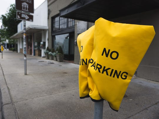 "Yellow ""No Parking"" bags cover parking meters in front of Vinyl Music Hall on Garden Street in Pensacola on Tuesday, April 11, 2017."