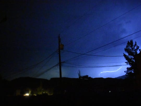 Lightning cracks across the sky late Wednesday night during a thunderstorm that hit Alamogordo with rain and 60 mph winds.