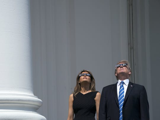 The Trumps view the solar eclipse from the Truman Balcony