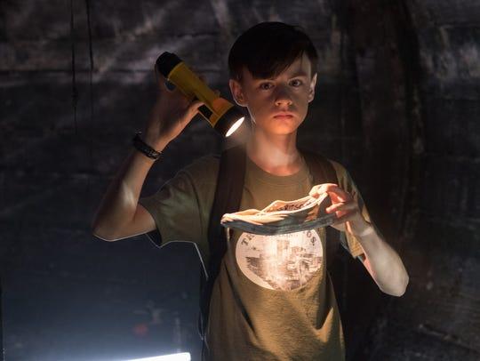 "Bill (Jaeden Lieberher) looks for clues in ""It."""