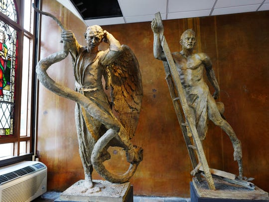 Sculptures of St. Michael the Archangel, center, the patron saint of police officers, and St. Florian, the patron saint of firefighters, are featured in St. Joseph's Chapel, Thursday, April 27, 2017, in New York.
