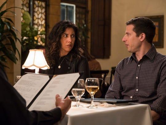 Stephanie Beatriz as Rosa and Andy Samberg as Jake