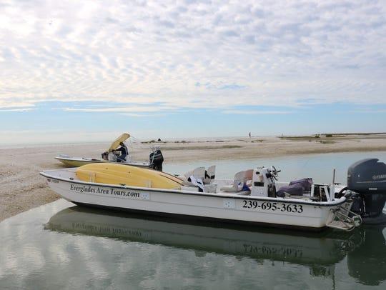 Board a small passenger boat at Goodland Marina, south