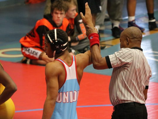 The ref raises Demetrius Griffen's hand as he wins his first match of the day.