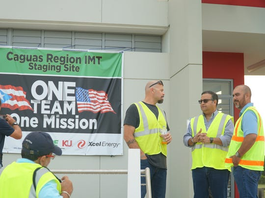Alex Ramirez, of AEP Texas, stands with other members of the Incident Management Team responsible for restoring power to Region 1 of Puerto Rico.