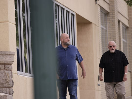 Tim Burns (left) walks to his appearance in federal court July 18, 2018, in downtown Sioux Falls, SD