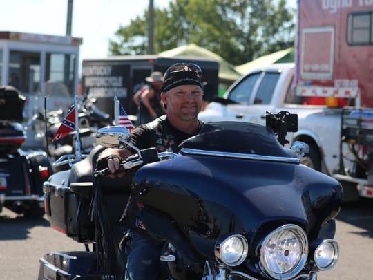 Steve Weirauch rides his bike through the rally.