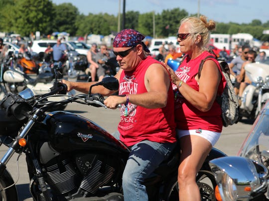 John Pike and Pam Pierson ride through the line for the Poker run on Saturday.