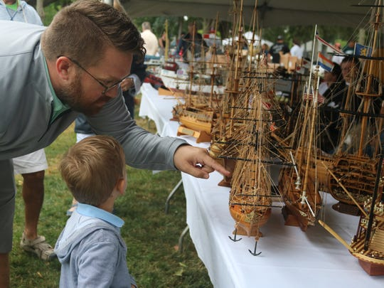 Paul and Oliver Stelzer, 3, enjoy some hand-crafted