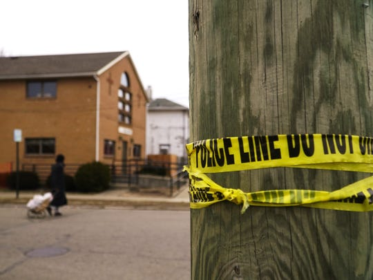Months after the killing of Benny Barefield, the remains of police tape linger at the corner of Yankee Road and Ninth Avenue in Middletown where Barefield was shot, Thursday Feb. 28, 2019.