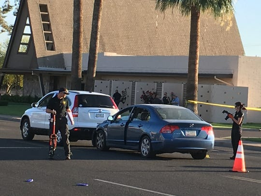 Phoenix police investigate the scene after a pregnant