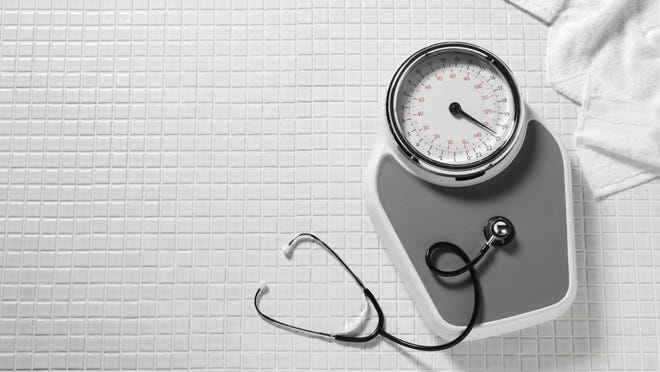 Bathroom scales and a stethoscope are shown.