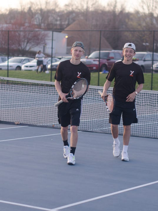 York Suburban's Michael Peck and Elliot Diehl walk off the court after winning their doubles match against York Catholic's Michael Andrews and Scott Bartkowiak. The Trojans' 6-4, 6-1 victory secured the 4-3 match victory for York Suburban.