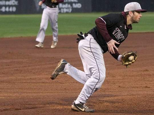 Hardin County's Cole Nix fields the ball against Huntingdon