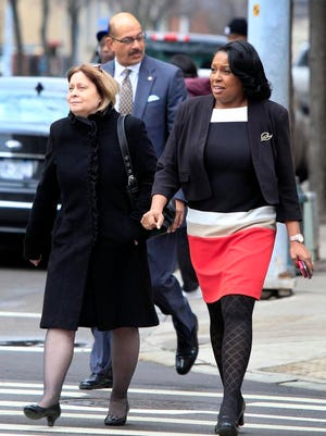 Rochester Mayor Lovely Warren, right, walks with   communications director Chris Christopher earlier this week. At center is Reggie Hill, her uncle, who admitted he was stopped twice for speeding last week.