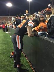 Oregon State wide receiver Jordan Villamin signs autographs