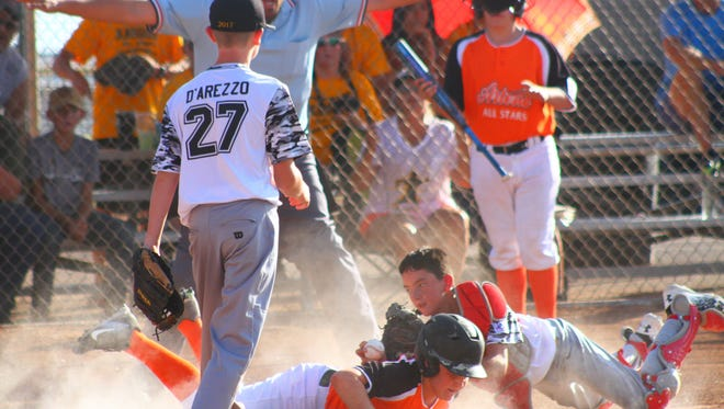 Rotary catcher Chris Bedgood lays out to tag an Artesia player Saturday night at the Griggs Sports Complex.
