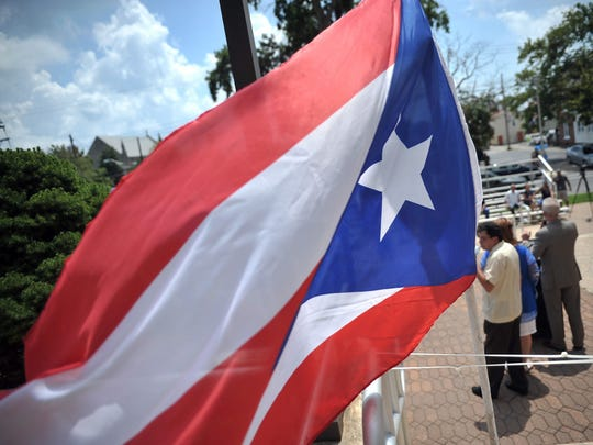 A Puerto Rican flag waves in the wind during  flag raising ceremony.
