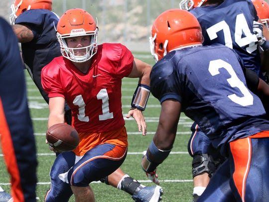Former UTEP quarterback Mack Leftwich hands off to then-running back Trayvon Hughes, 3, during a 2015 scrimmage game at Glory Field.